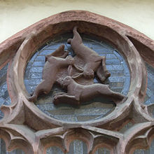 220px-Paderborner_Dom_Dreihasenfenster The Three Hares